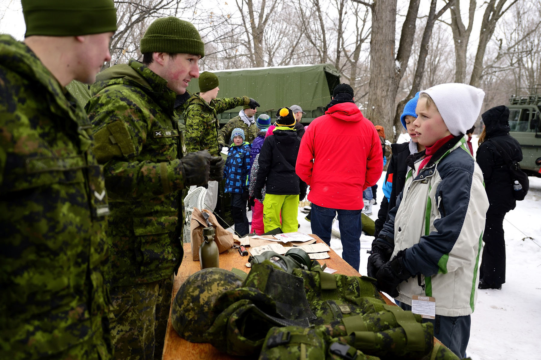 Members of the Governor General's Foot Guards introduced visitors to some of their training exercises with a fun obstacle course and demonstrated how a military camp is set up for winter.