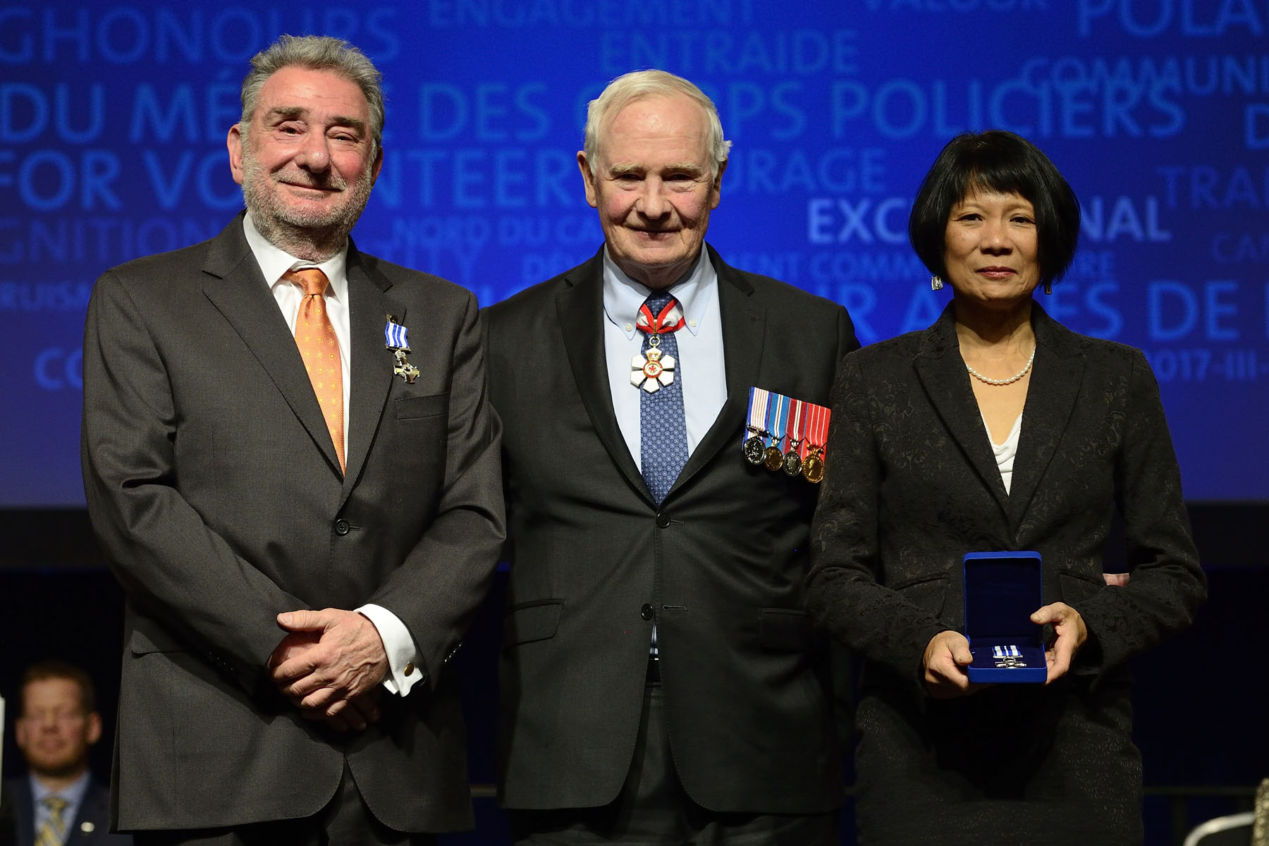 His Excellency presented the Meritorious Service Cross (Civil Division) to The Honourable Jack Layton, P.C., M.S.C. (posthumous) and Ronald Sluser, M.S.C. Michael Kaufman, M.S.C. Michael Kaufman, Jack Layton and Ron Sluser challenged negative concepts of masculinity by getting men to talk about gender equality. Their efforts sparked the White Ribbon Campaign, which encourages men and boys to pledge to never commit, condone or remain silent about violence against women and girls. Today, the movement has spread to 60 countries, and continues to promote a safe and equitable future by having fathers and other male role models talk to boys about respect and healthy relationships. The Meritorious Service Cross awarded to Dr. Kaufman will be presented to him at a later date. The Meritorious Service Cross awarded to the late Honourable Jack Layton was presented to his spouse, Ms. Olivia Chow.