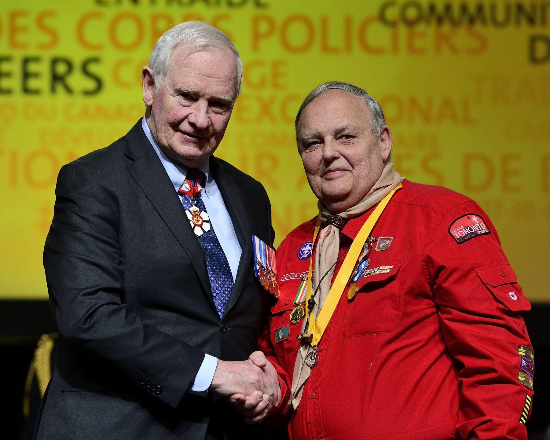 His Excellency presented the Sovereign's Medal for Volunteer to Doug Gough. For more than 50 years, Mr. Gough has been volunteering in various capacities with Scouts Canada, most recently as registrar of the Greater Toronto Council, where he helps administer the No One Left Behind program. Since 2011, he has been working with the Hospital for Sick Children (SickKids) in Toronto to help young patients register for modified scouting programs.