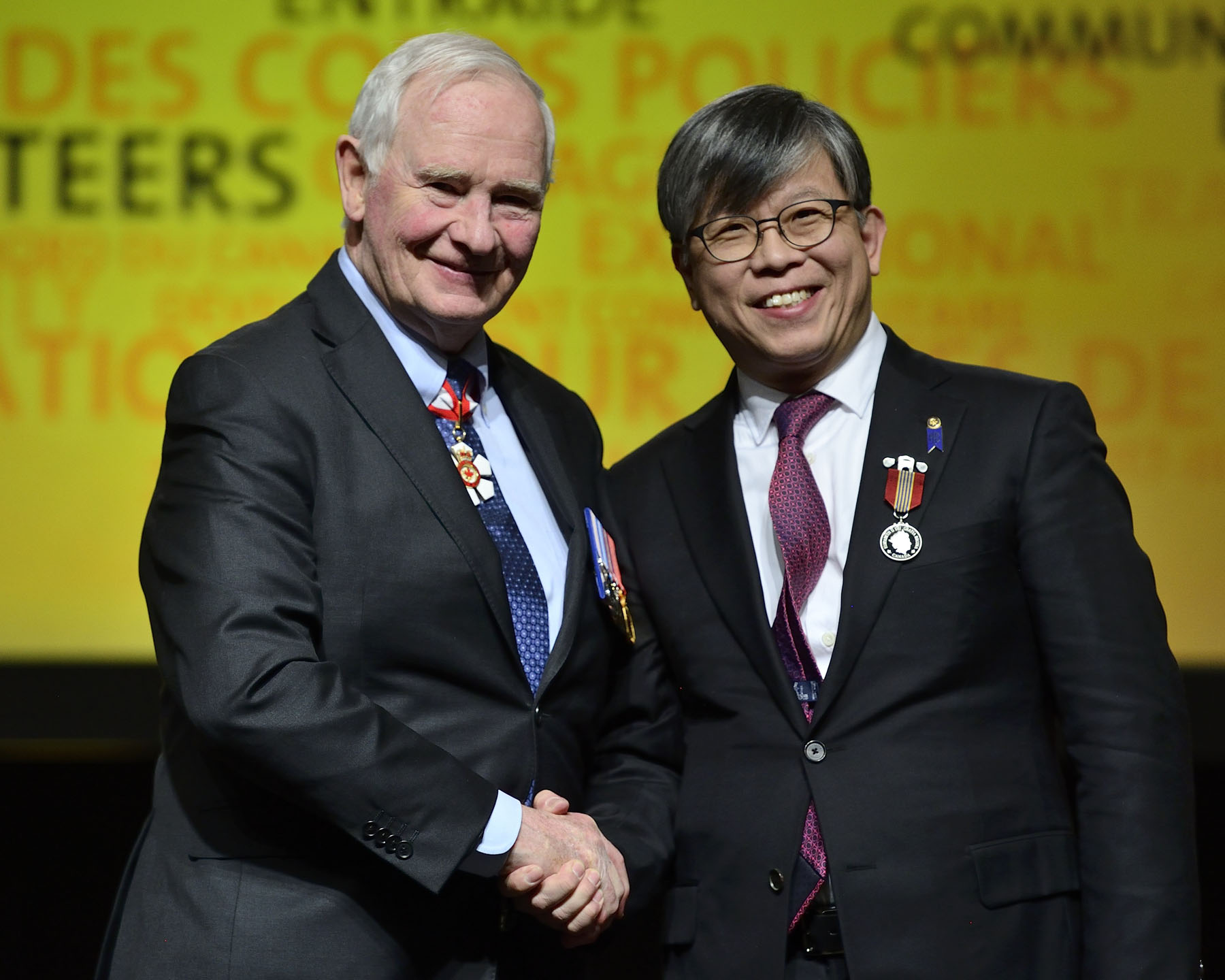 His Excellency presented the Sovereign's Medal for Volunteer to Benny Kwok Man Tam. As a volunteer with the 11th Toronto Scout Group since its founding in 1990, Mr. Tam has been assisting with the delivery of the youth program, coordinating fundraisers and developing training programs. From 1990 to 1994, he was also part of a network that helped new Hong Kong immigrants integrate into the Toronto community.