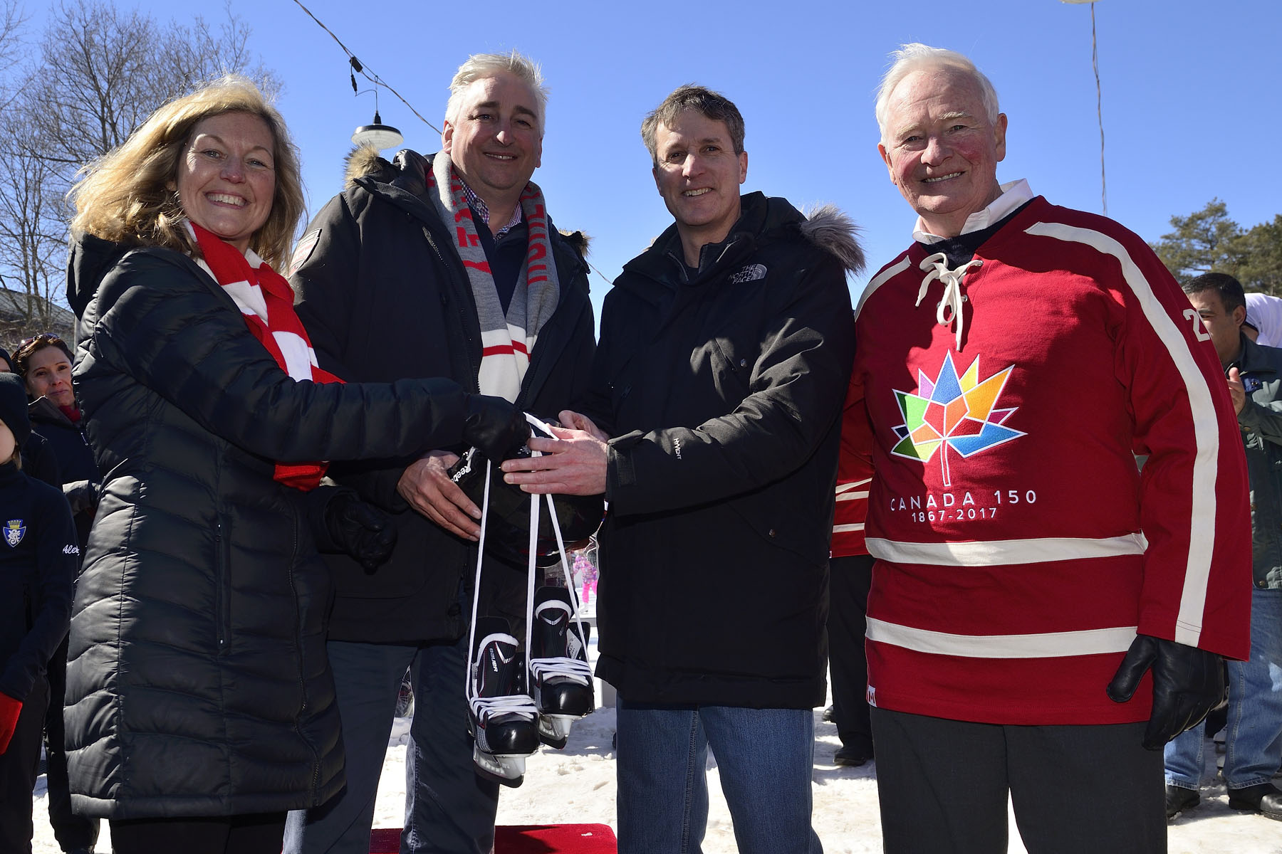 Mr. Erich Forler, president of the Board of Directors of the Minto Skating Club received the first Skate Bank from Ms. Debra Armstrong, Chief Executive Officer of Skate Canada and Mr. Dale Hooper, Chief Brand Officer of Rogers Communications. A skate bank of skates and helmets will be donated to skating communities that will take part in the Canada 150 Skating Day program across the country.
