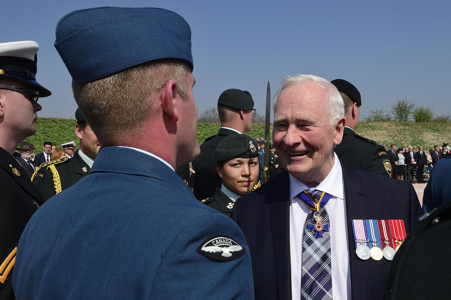 The Governor General inspected the rows of the guard of honour.