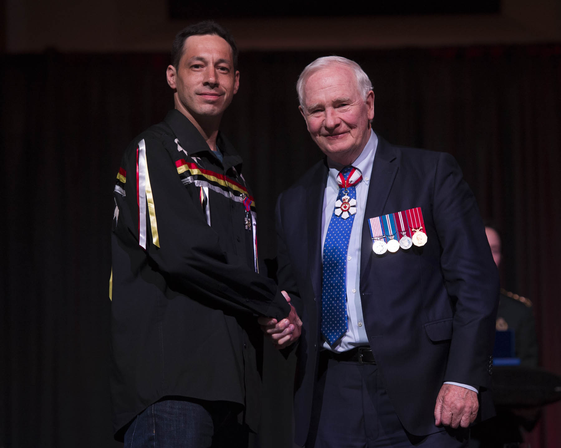His Excellency presented the Star of Courage to Liam Bernard, S.C. On September 16, 2016, Liam Bernard rescued two people from a burning truck near Melford, Nova Scotia. Following a collision, the truck had rolled into a ditch, trapping the victims inside. As Mr. Bernard pulled the first victim to safety, a fire broke out under the truck's hood and quickly spread into the cab. Mr. Bernard climbed inside to try and free the driver, but was forced to retreat due to the heavy smoke. Undeterred, Mr. Bernard returned to the vehicle and, with the help of bystanders, pulled the victim over to the passenger side and out of harm's way.