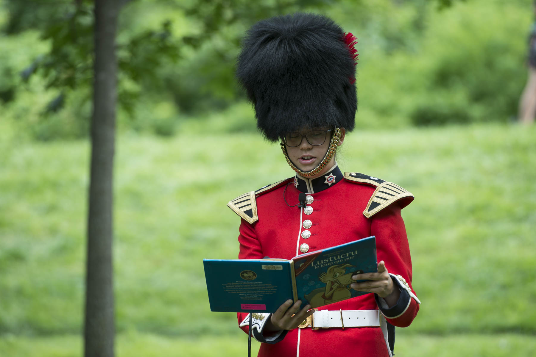 "Musician Julie Olson of the Band of the Ceremonial Guard read ""Lustucru, le loup qui pue"", by author and Order of Canada member Dominique Demers."