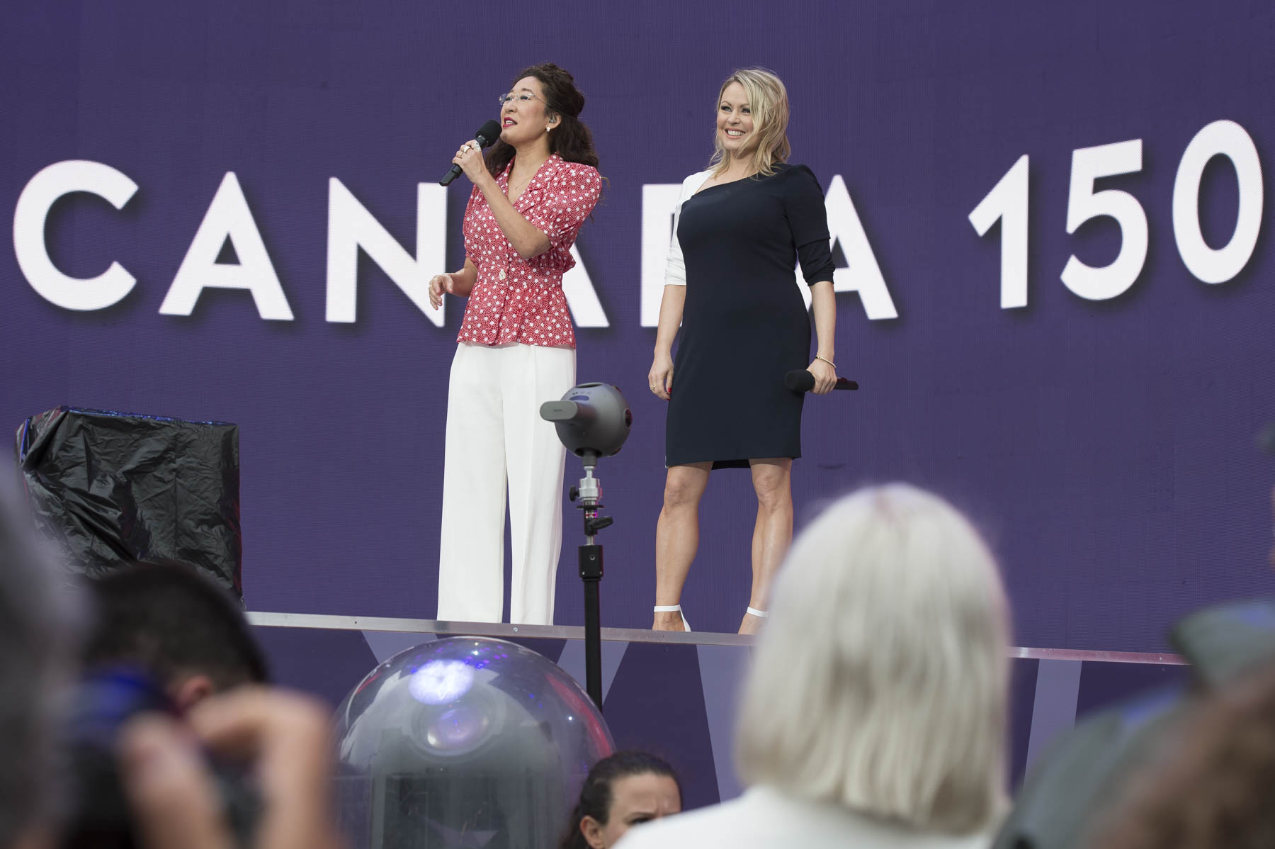Sandra Oh and Mitsou were the masters of ceremony for the Canada Day Noon Show.