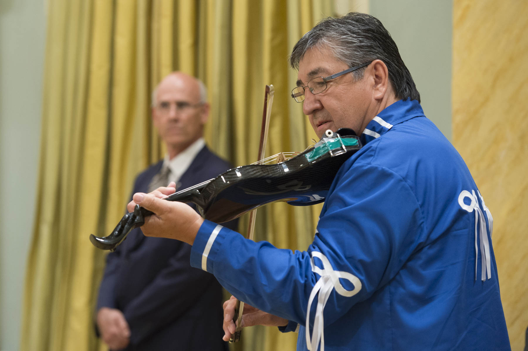 The ceremony began with Métis Elder Olivier Boulet, who played fiddle as  music as ministers designate,  the Right Honourable, Justin Trudeau, Prime Minister of Canada, and Their Excellencies  entered the Ballroom.