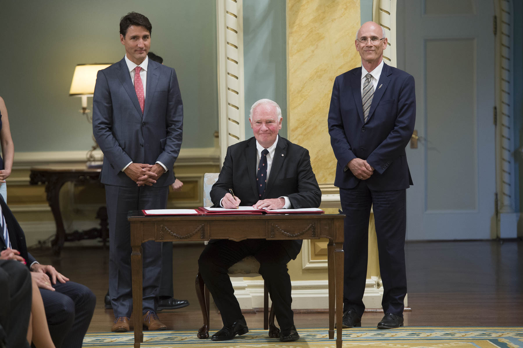 Following the swearing-in of the last new member of the ministry, the governor general, the prime minister and the clerk of the Privy council signed the oath books to formally attest to the swearing-in of the ministry.