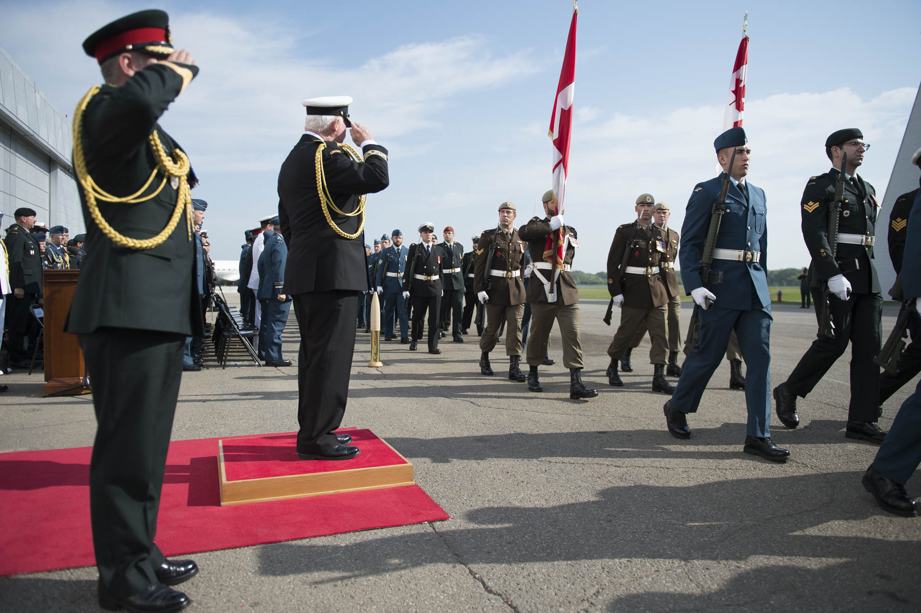 The Governor General and the Chief of Defence Staff saluted members of the Honour Guard as they marched past the dias.