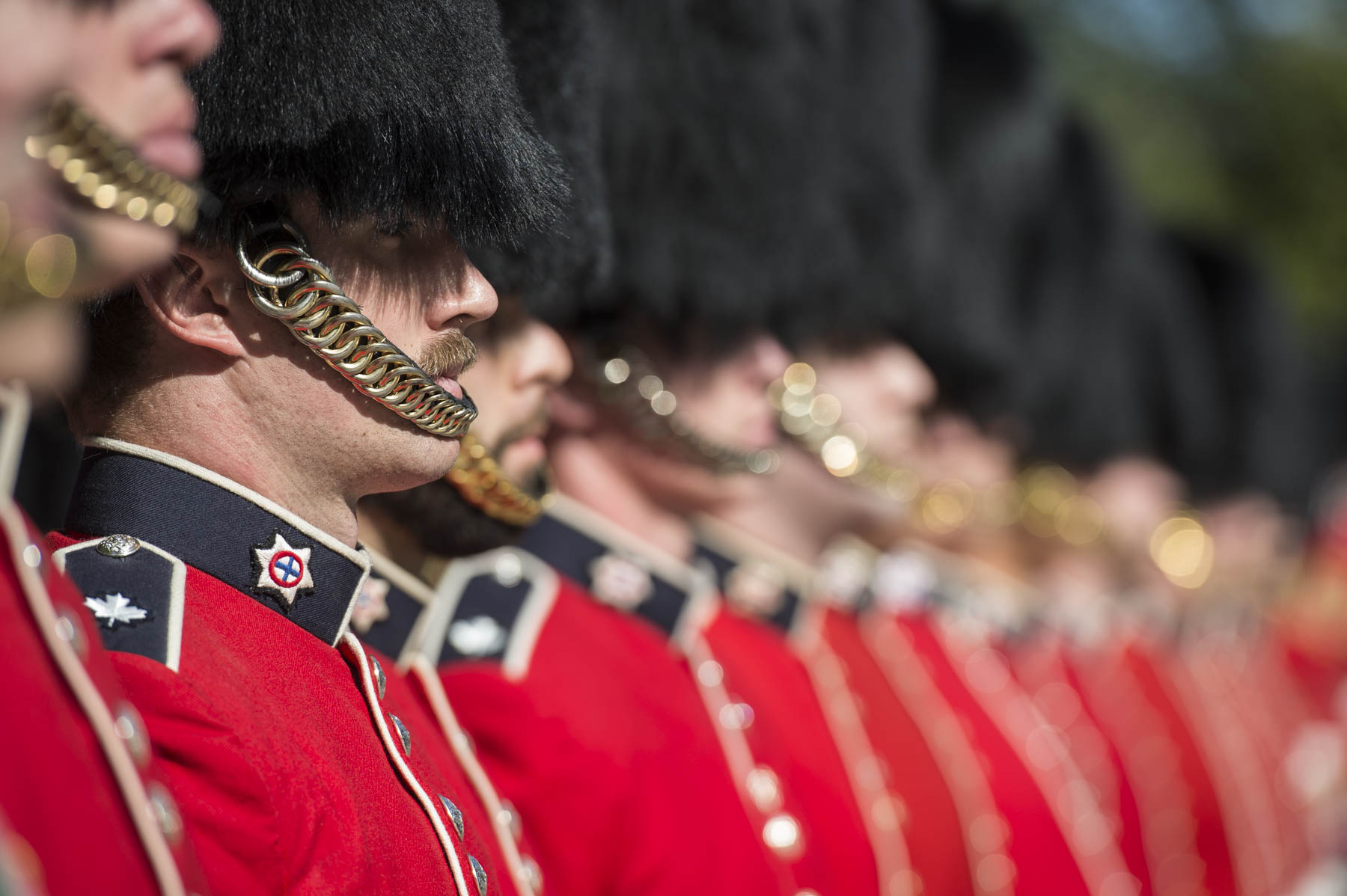 The 100-person guard of honour was composed of men and women from the Canadian Grenadier Guards and the Governor General's Foot Guards, two of the household regiments.
