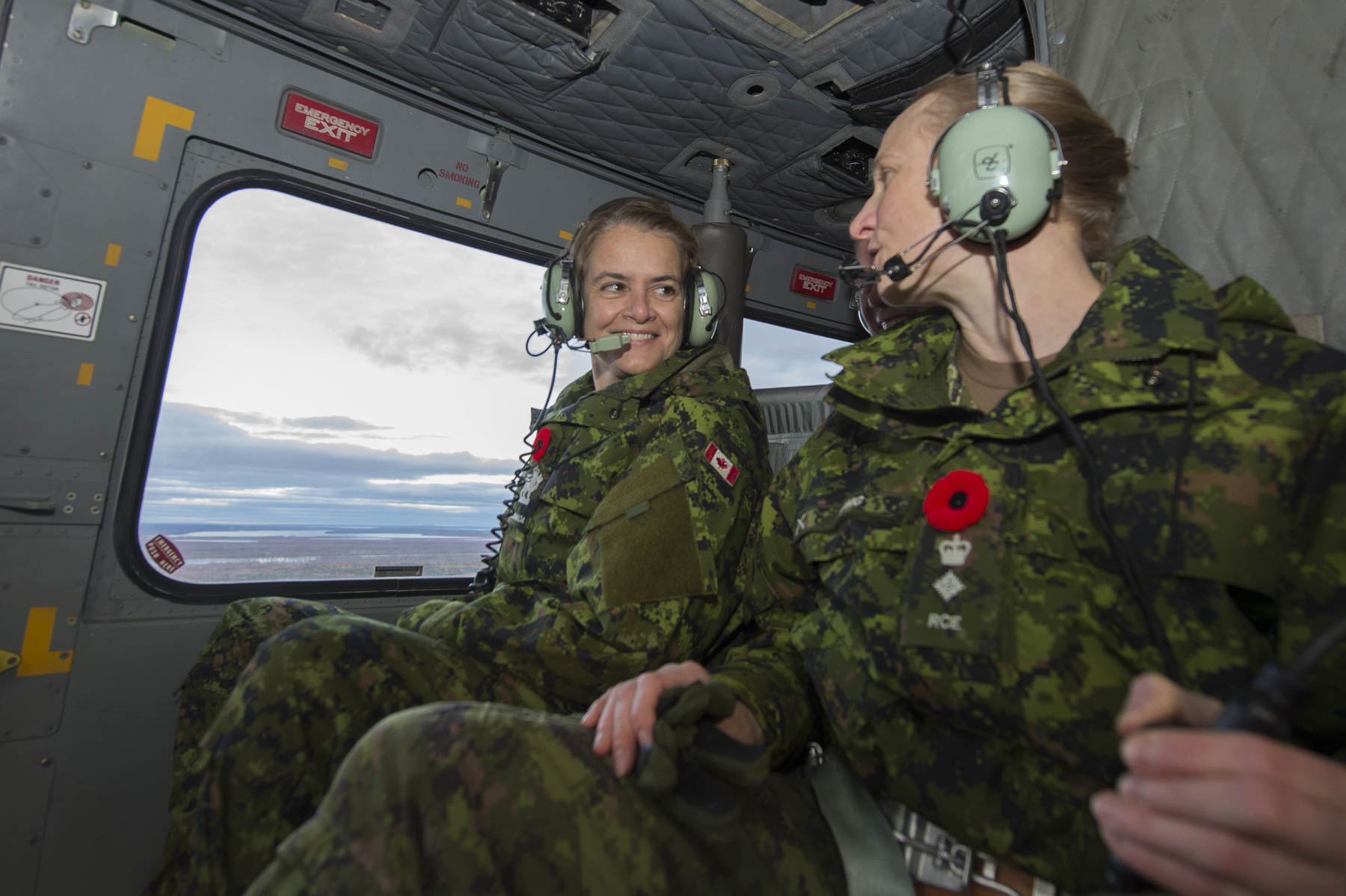 Her Excellency flew over the base in a helicopter.