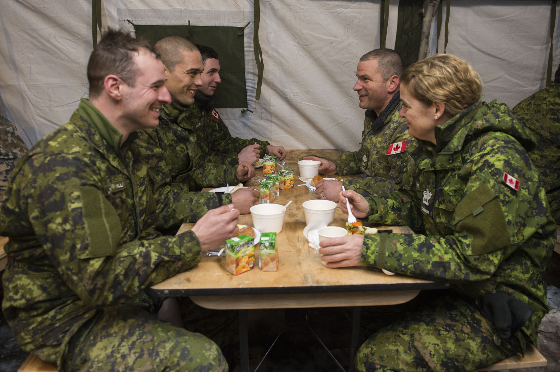 Her Excellency had an opportunity to chat with troops over a meal.