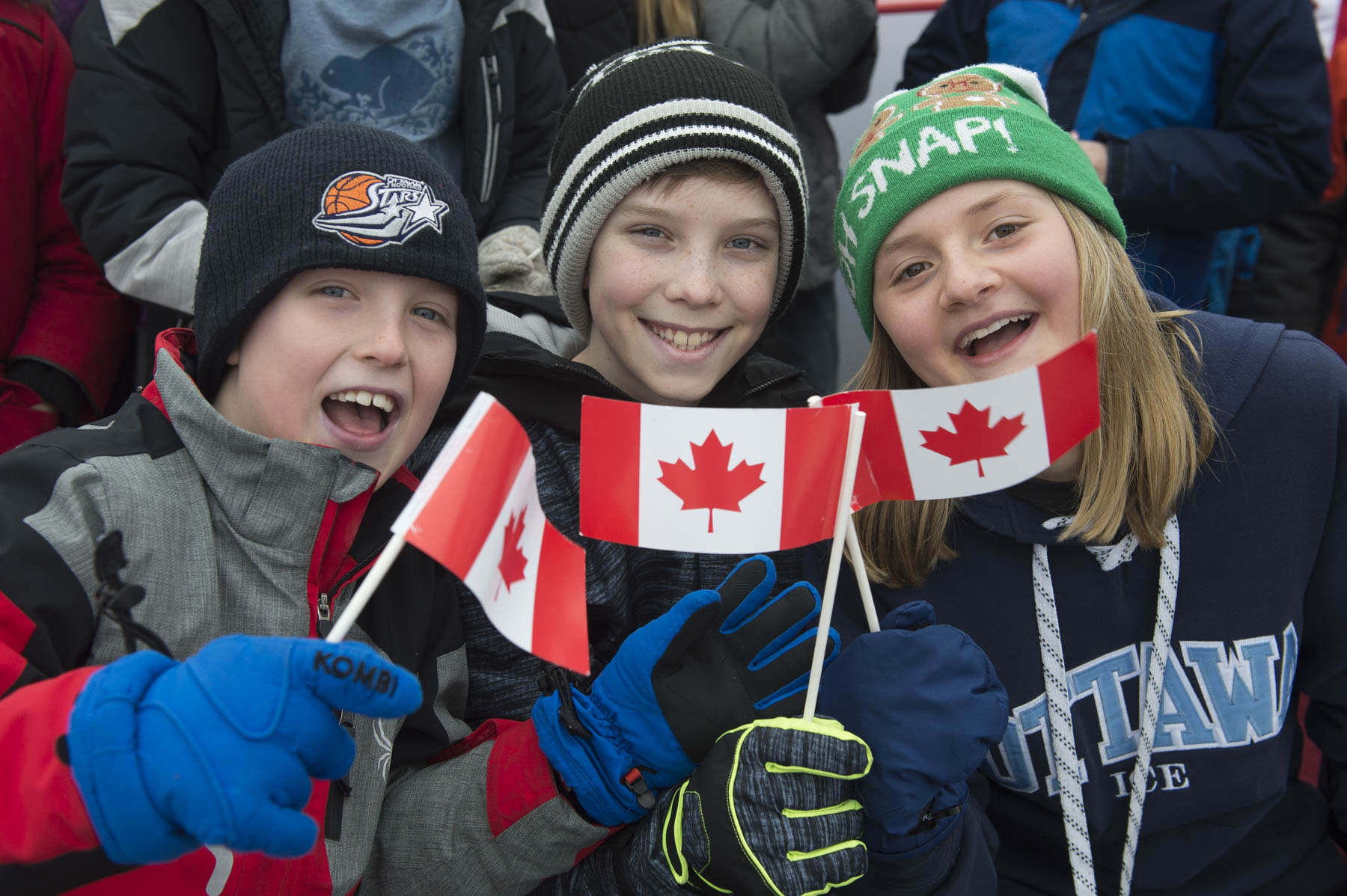 Members of the public watched the ceremony with their Canadian flags in hand.