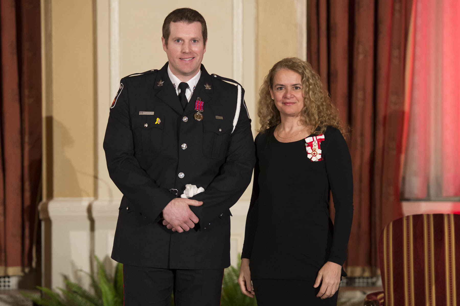 On January 14, 2014, Constable Thomas Broadfoot, of the Durham Regional Police Service, rescued a man following a car accident in Ajax, Ontario. He crawled into the overturned vehicle on his hands and knees, but was briefly forced back by the strong fumes of gasoline pooling inside the car. Despite the risk of a fire or explosion, he re-entered the vehicle to shield the victim from the gasoline exposure and remained with him until emergency services arrived.