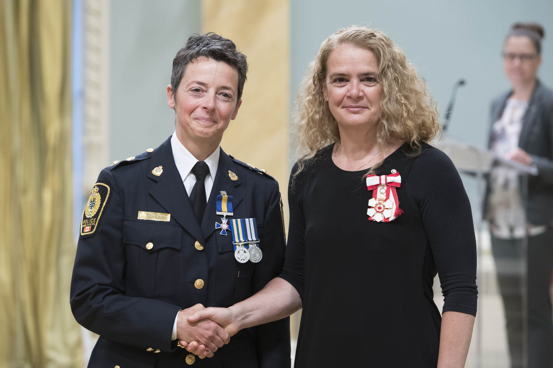The Governor General presented the Order of Merit of the Police Forces to Superintendent Cita Carmen Airth. She has been a distinguished member of the Vancouver Police Department for over 20 years. A natural leader and mentor, she has developed innovative strategies to promote women's rights within her community.