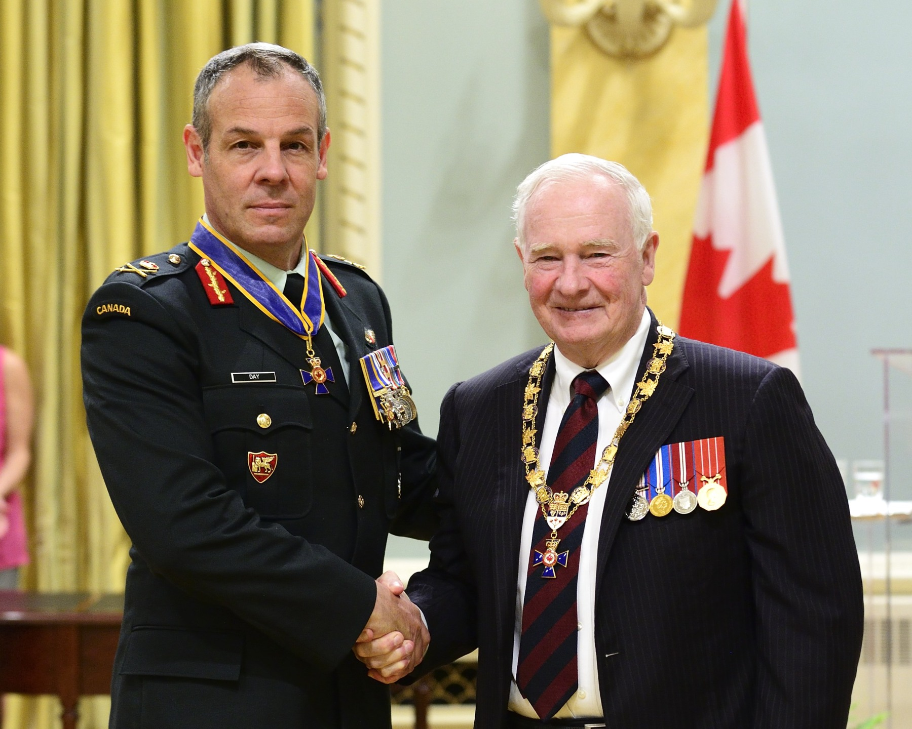 His Excellency presented the Order of Military Merit at the Commander level (C.M.M.) to Lieutenant-General Michael Day, C.M.M., M.S.C., C.D., Chief of Force Development, Ottawa, Ontario. This is a promotion within the Order.