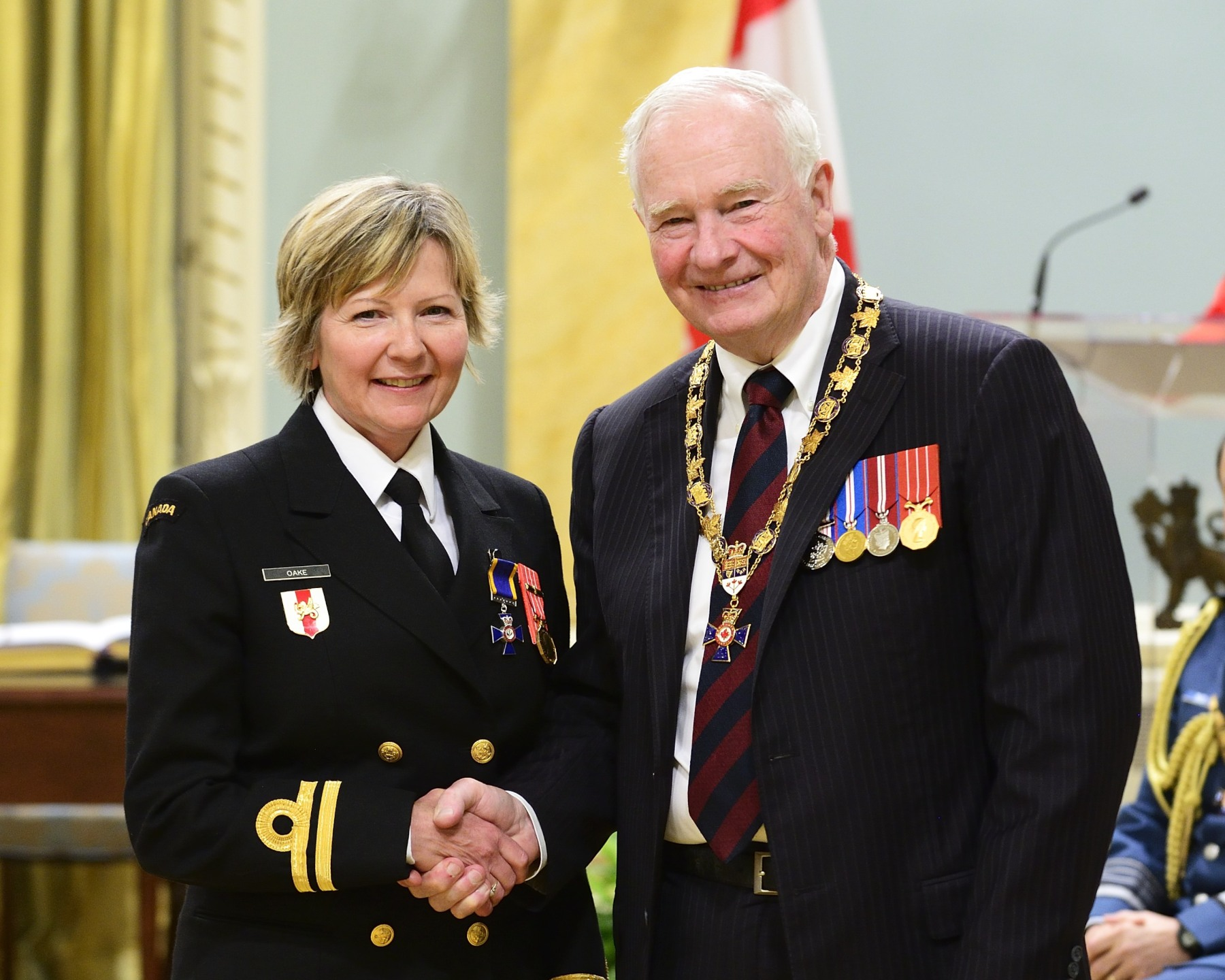 His Excellency presented the Order of Military Merit at the Member level (M.M.M.) to Lieutenant(N) Heather Oake, M.M.M., C.D., Joint Personnel Support Unit Detachment Halifax, Halifax, Nova Scotia.