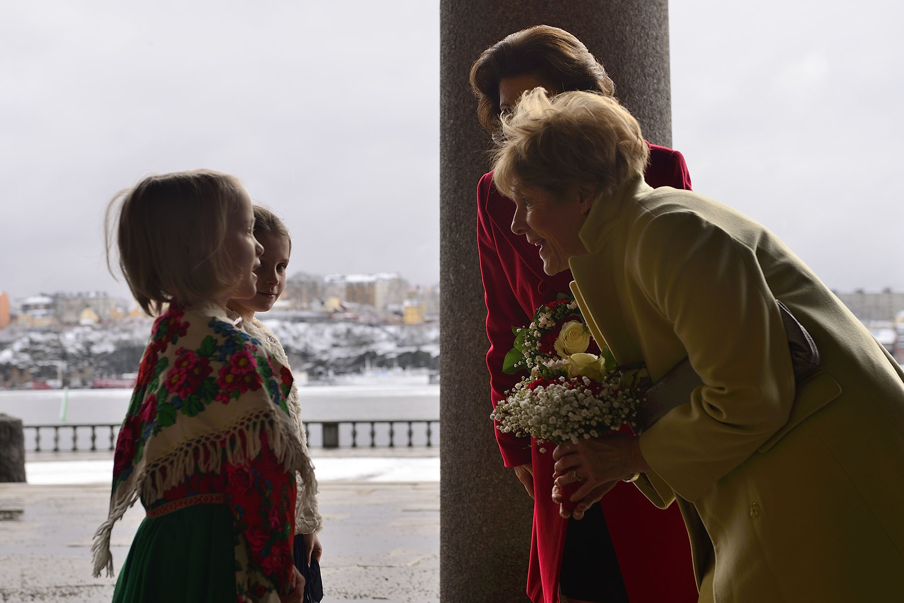 Upon arriving at Stockholm City Hall for a working luncheon, Mrs. Johnston was offered flowers by two young Swedish girls.