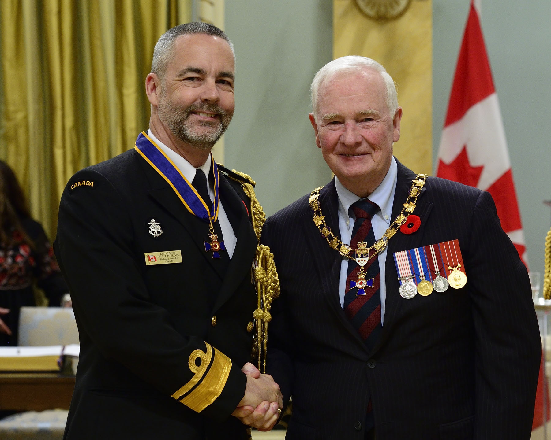 Son Excellence a remis l'Ordre du mérite militaire du grade Commandeur (C.M.M.) au contre-amiral William Shawn Truelove, C.M.M., C.D., État-major de liaison des Forces canadiennes (Washington), Washington (D.C., États-Unis d'Amérique). Il s'agit d'une promotion au sein de l'Ordre.