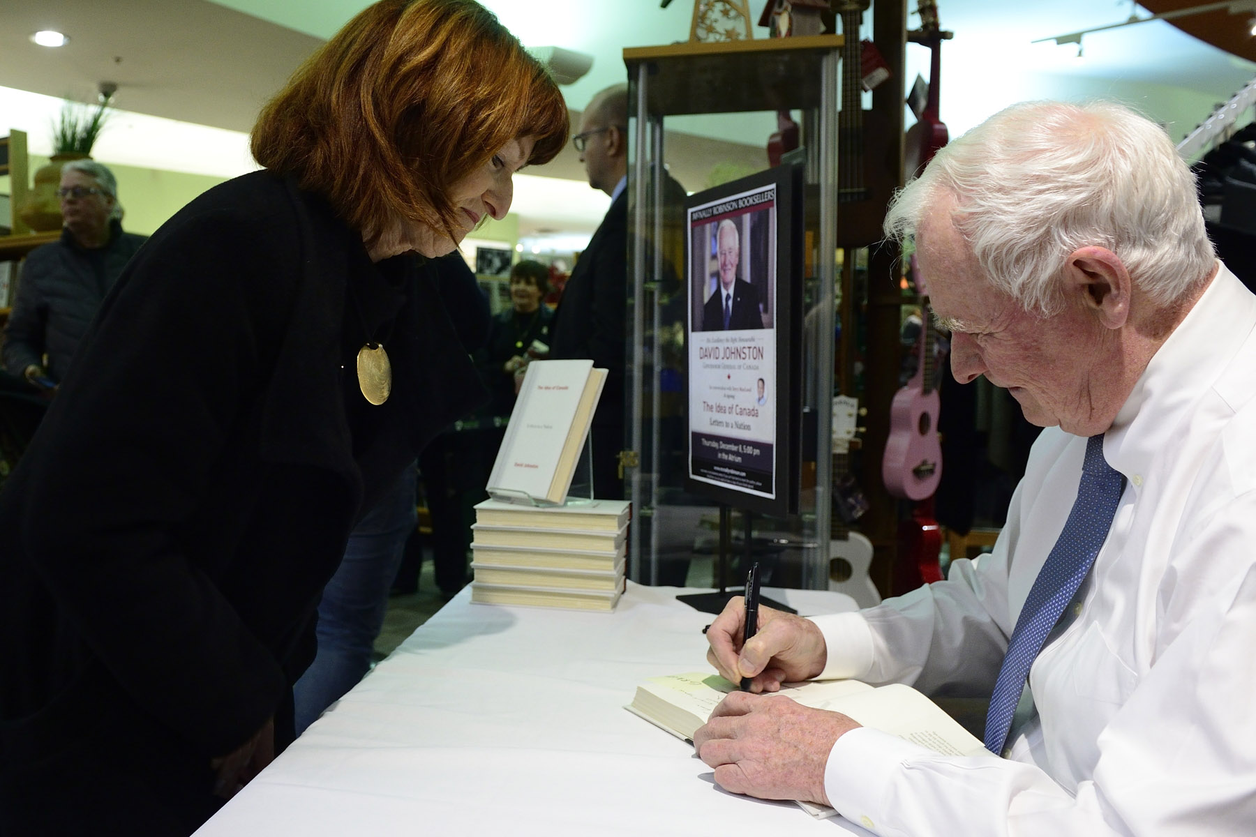 Afterwards, Hi Excellency signed copies of his book.