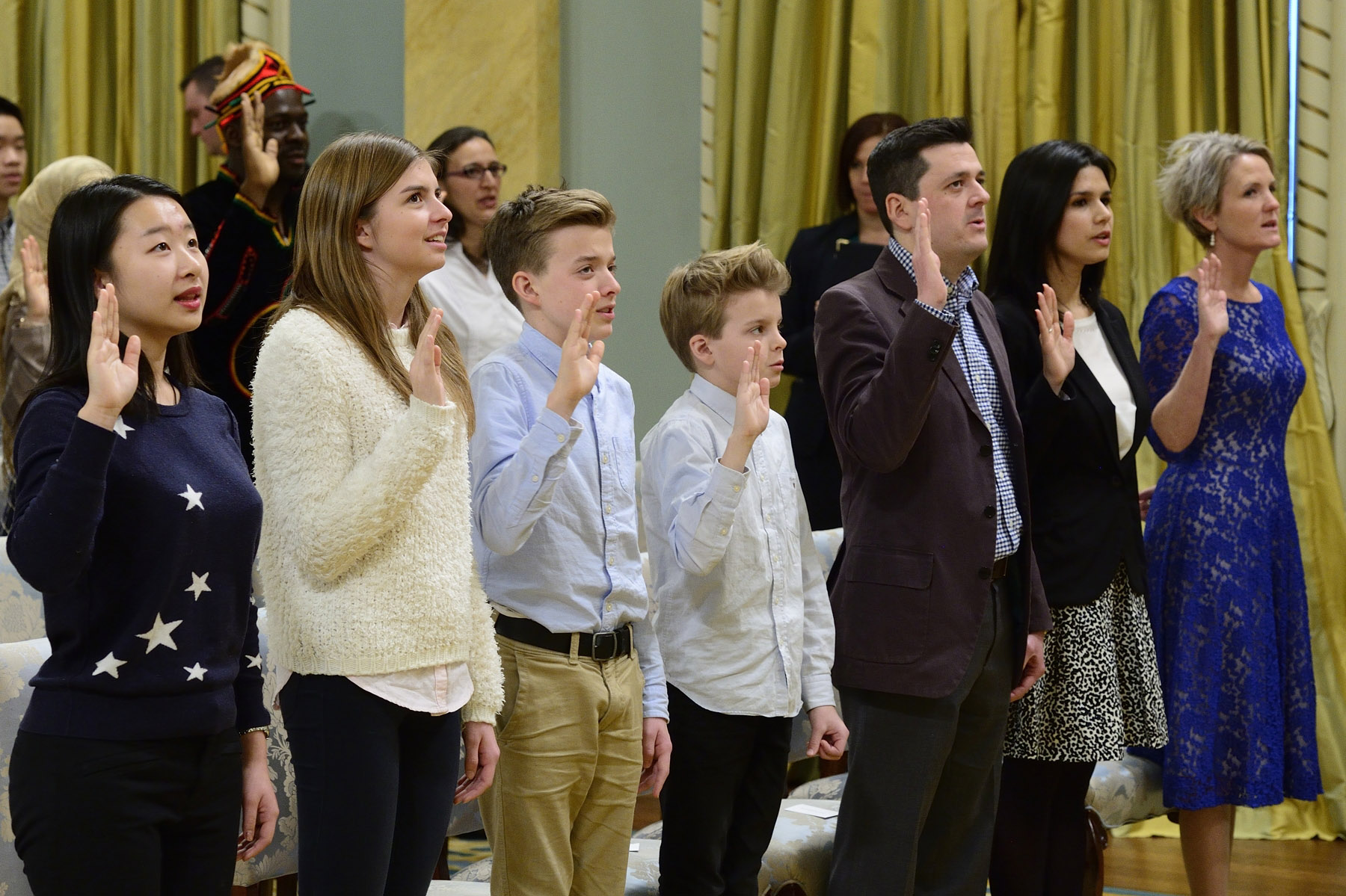 New Canadians repeated the Oath of Citizenship after His Excellency.