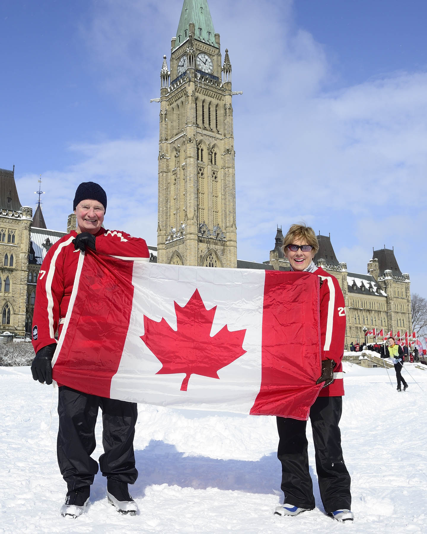 On the occasion of Flag Day, Their Excellencies took a photo with the Canadian flag in front of the Peace Tower.