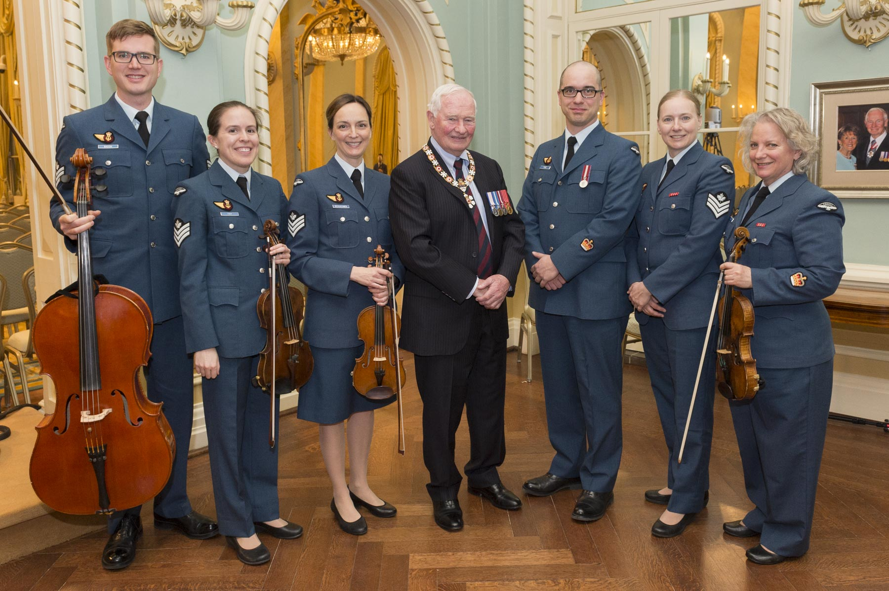 The Governor General posed for a photo with Warrant Officer Simon Paré and the Canadian Armed Forces String Ensemble.