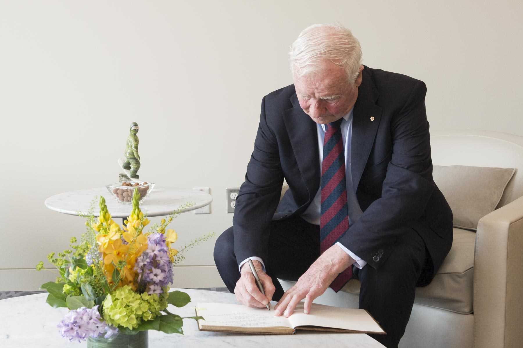 The Governor General signed the Centre's official guestbook.