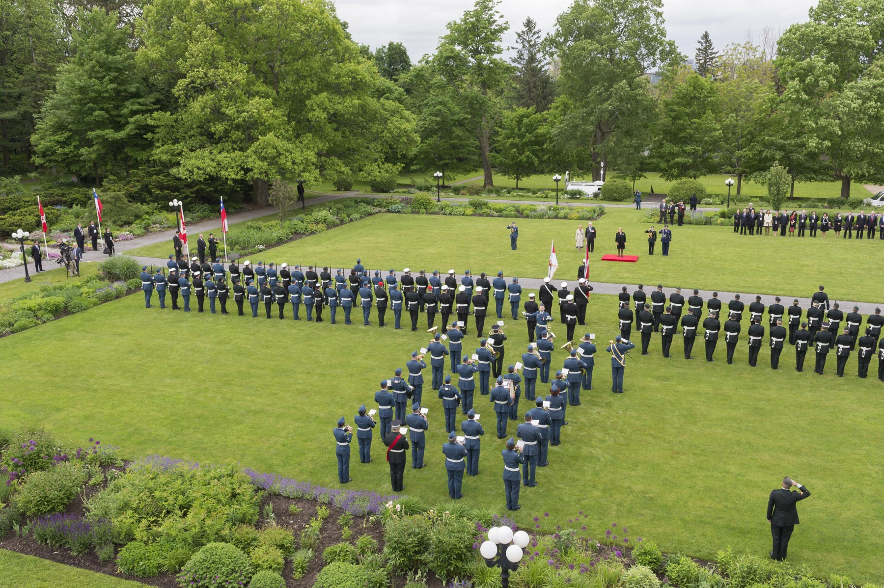 The guard of honour was composed of members from the Canadian Army, the Royal Canadian Navy and the Royal Canadian Air Force.