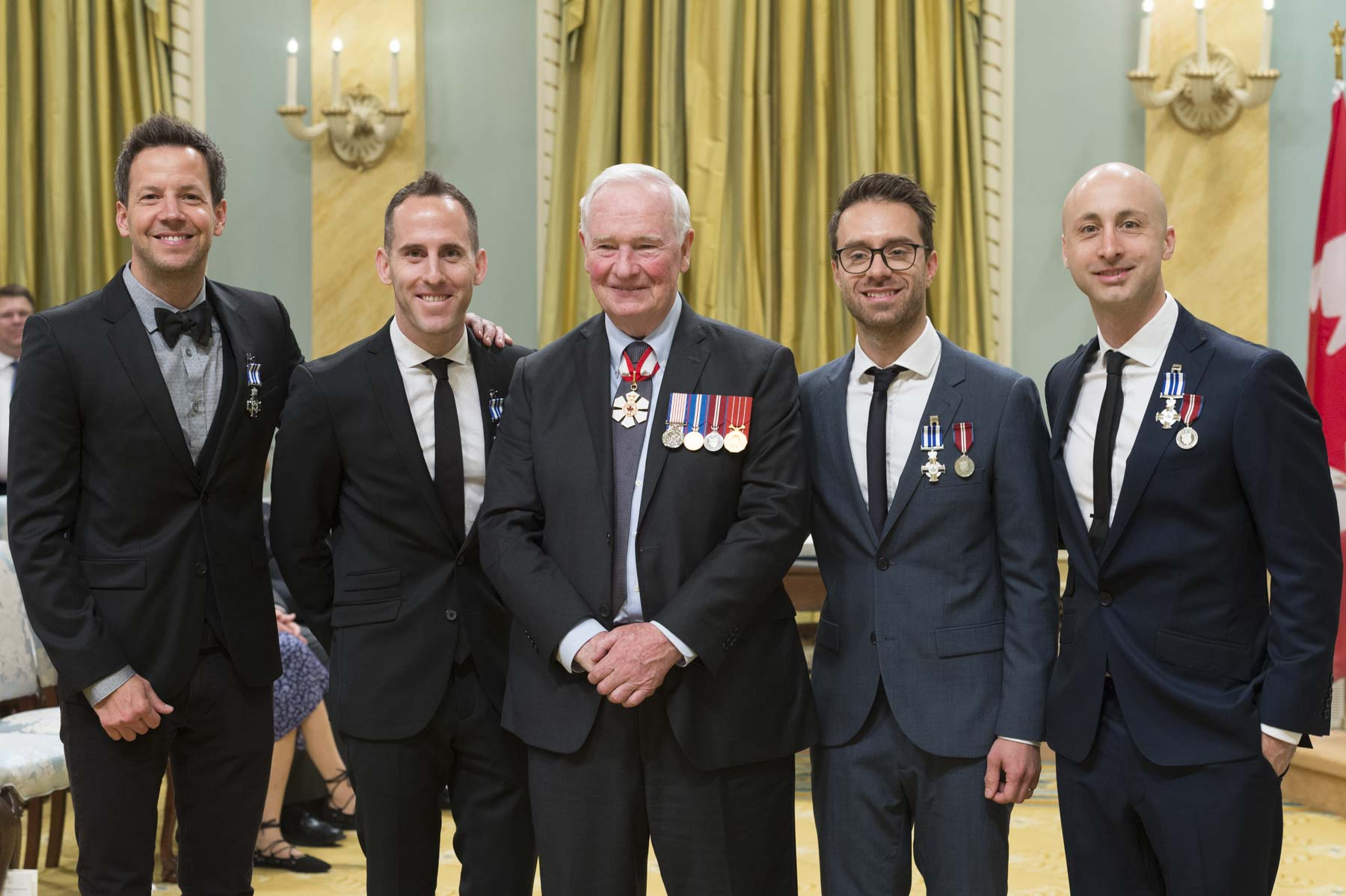 His Excellency presented the Meritorious Service Cross to Pierre Bouvier, Charles-André Comeau, Sébastien Lefebvre and Jean-François Stinco. Through their foundation, the members of Simple Plan, a world-renowned rock band, have made it their mission to help youth in need. Appreciated for both their philanthropy and community involvement, they actively support numerous charitable projects, lending their star power and giving of their time, both in Canada and abroad.