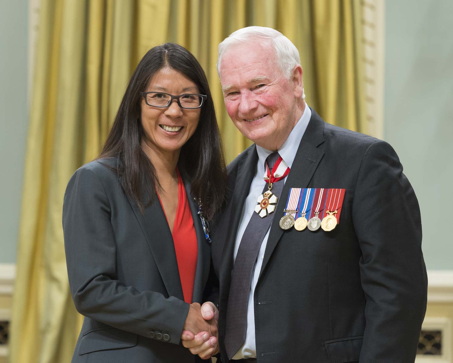 His Excellency presented the Meritorious Service Cross to Dr. Joanne Liu. As the international president of Doctors Without Borders/Médecins Sans Frontières, Dr. Joanne Liu demonstrated exceptional leadership in running the organization's clinical and epidemiological response to the largest Ebola outbreak in history. She advocated for the rights of sick people, inspired the teams on the ground with frequent visits, and called for a global humanitarian response to contain, control and mitigate the epidemic.
