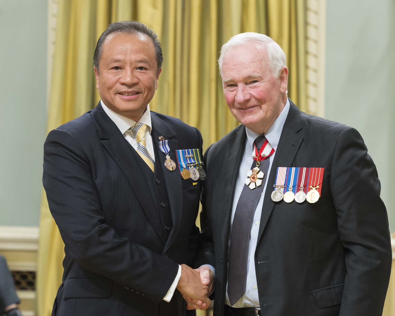 His Excellency presented the Meritorious Service Medal to Constable Rico Wong. In 2000, constables Ashford, Ng and Wong, Corporal Gyorfi, Sergeant MacDonald, and civilian member Ma represented the RCMP within an international law enforcement team tracking heroin traffickers in Fiji. Their successful covert operation led to the capture of seven traffickers and the seizure of 350 kilograms of heroin destined for Canadian markets. Equally impressive, these members undertook their work during a political coup and in a hostile environment at great peril to themselves.