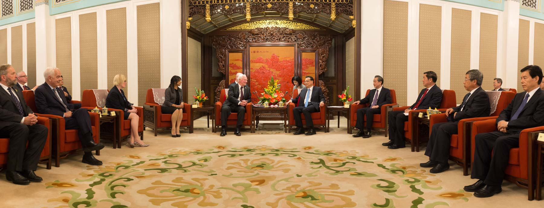 Members of the Canadian delegation and representatives of the Beijing government joined them for the meeting.