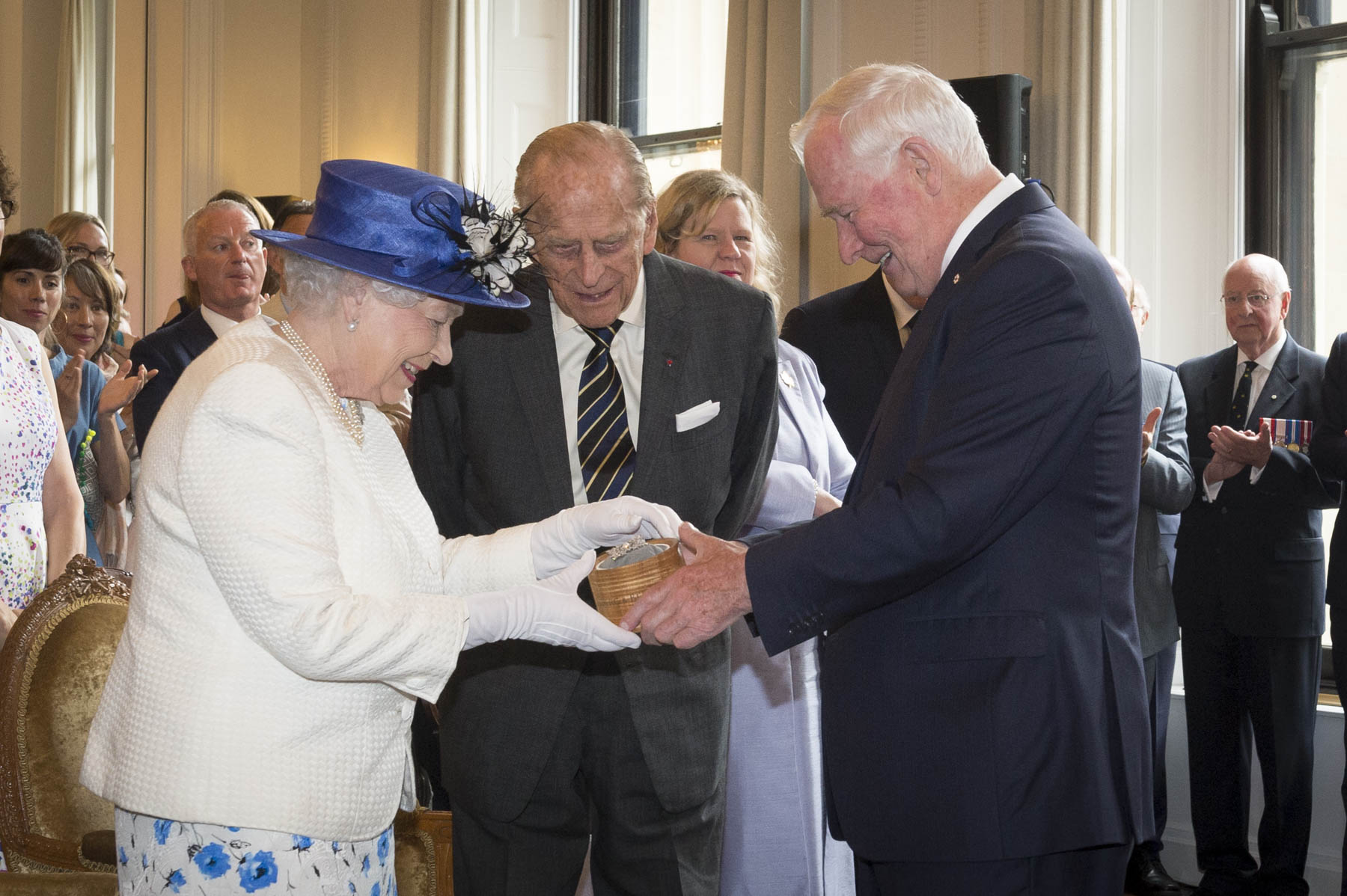 During the event, His Excellency presented Her Majesty with the Sapphire Jubilee Snowflake Brooch. The brooch celebrates The Queen's Sapphire Jubilee, marking 65 years as Canada's Sovereign.