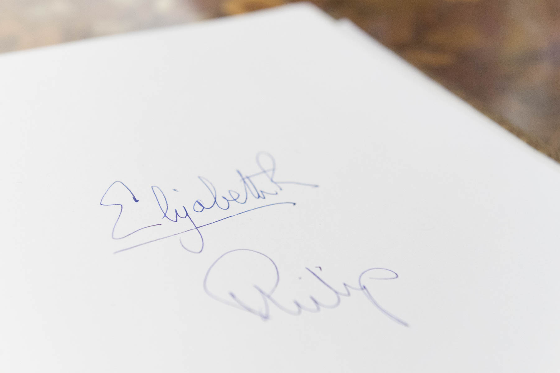 The Queen and The Duke of Edinburgh's signatures in Canada House's guest book.