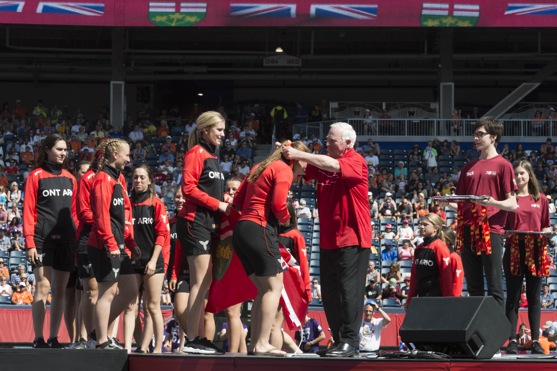 Before officially closing the Games, the Governor General presented the bronze medal to Team Ontario's women's softball.