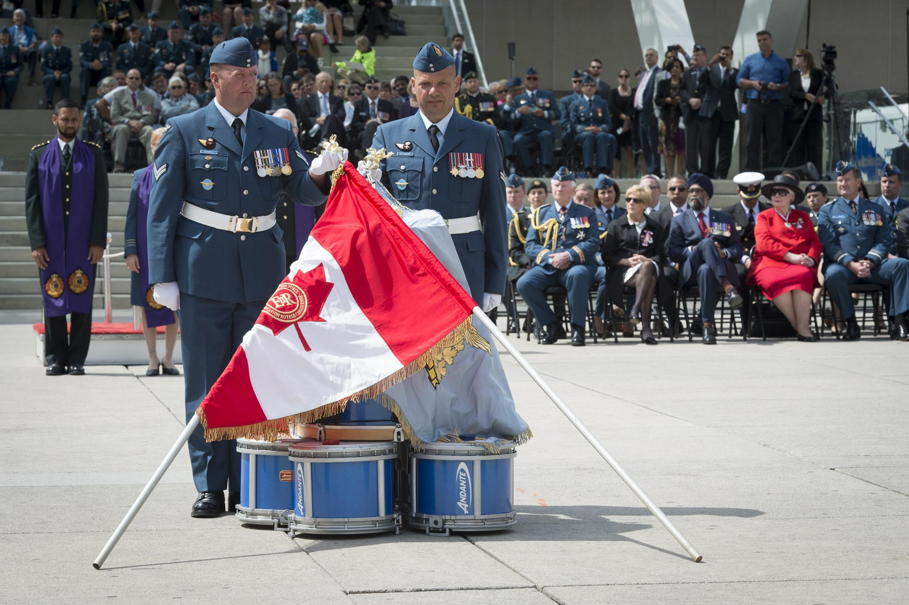 The RCAF carries two Colours which include: the Queen's Colour, a maple leaf flag with the Sovereign's cypher in the centre, which symbolizes loyalty to the Crown, and the Command Colour, a blue flag with the RCAF's badge at the centre, symbolizing the RCAF's pride, cohesion, and valour.