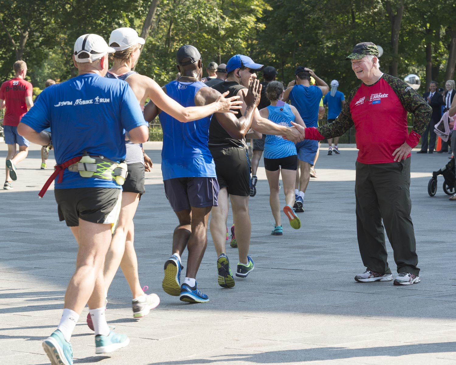 The Governor General cheered on runners as they arrived in front of the official residence.