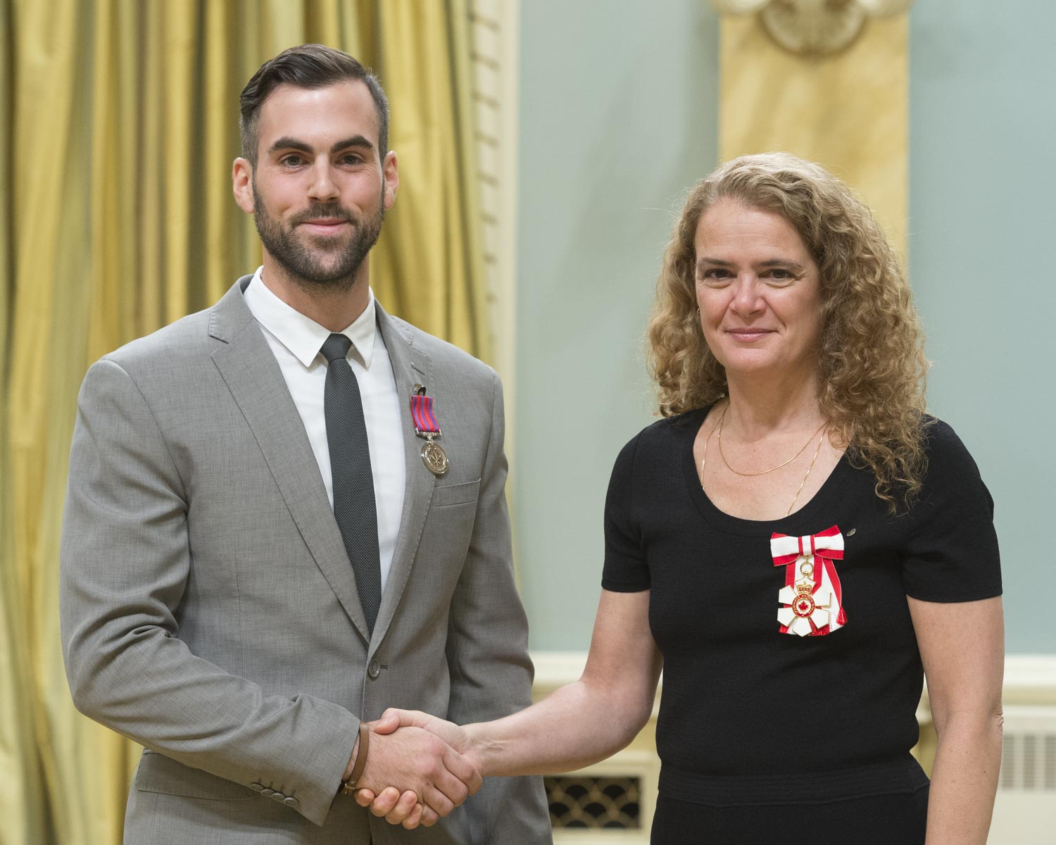 On October 7, 2014, Montréal police constables Steve Demers and Samuel Poirier-Payette (pictured left) put their lives at risk as they attempted to rescue a mother and her son from a burning house in Beaconsfield, Quebec. The officers first tried to reach one of the victims in the basement but were quickly driven back by the heat and heavy smoke. Hearing screams from the second victim on the main floor, the two constables struggled through the smoke until they reached the woman, but she refused to leave without her son, who was still in the basement. Constable Demers fell twice while attempting to drag the woman outside, but finally succeeded with the help of his colleague. Sadly, the victim's son did not survive. The decoration awarded to Constable Demers will be presented to him at a future ceremony.