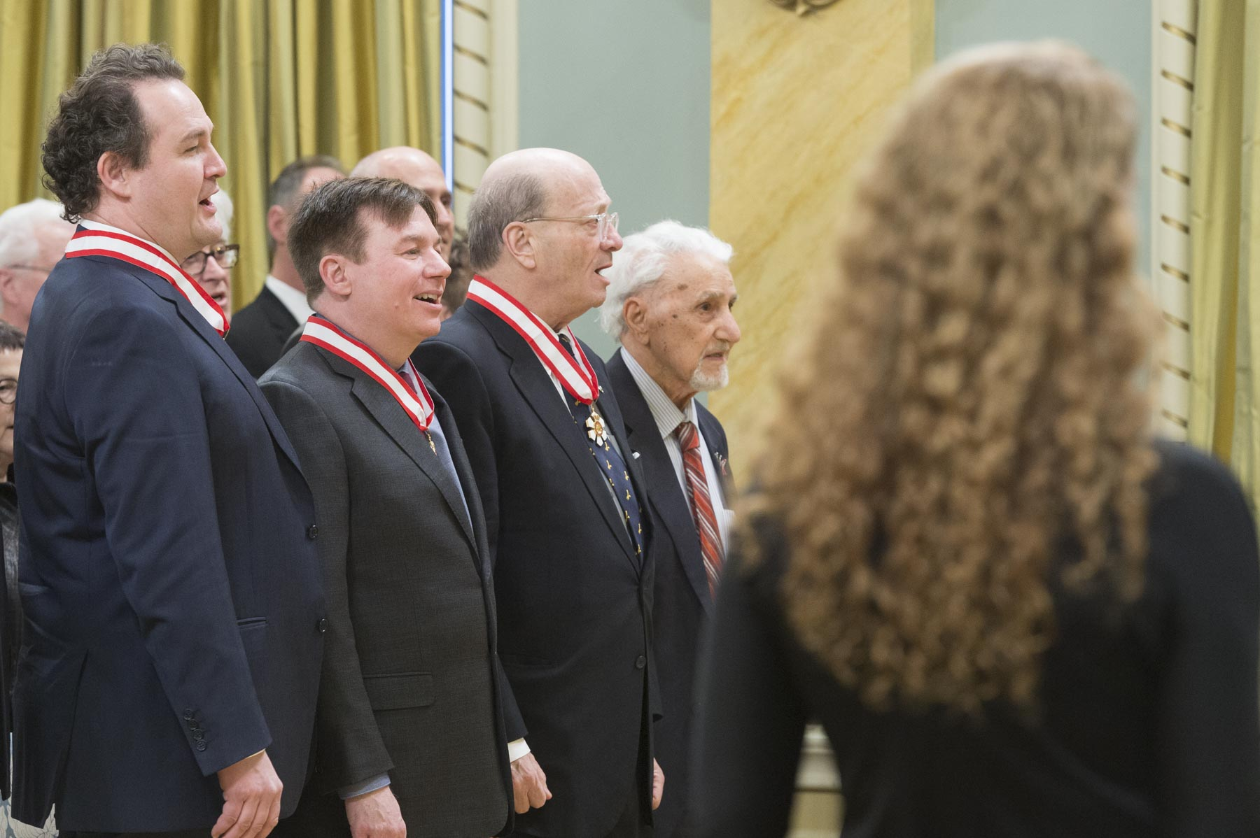 To close the ceremony, recipients and guests sang the national anthem in unison.