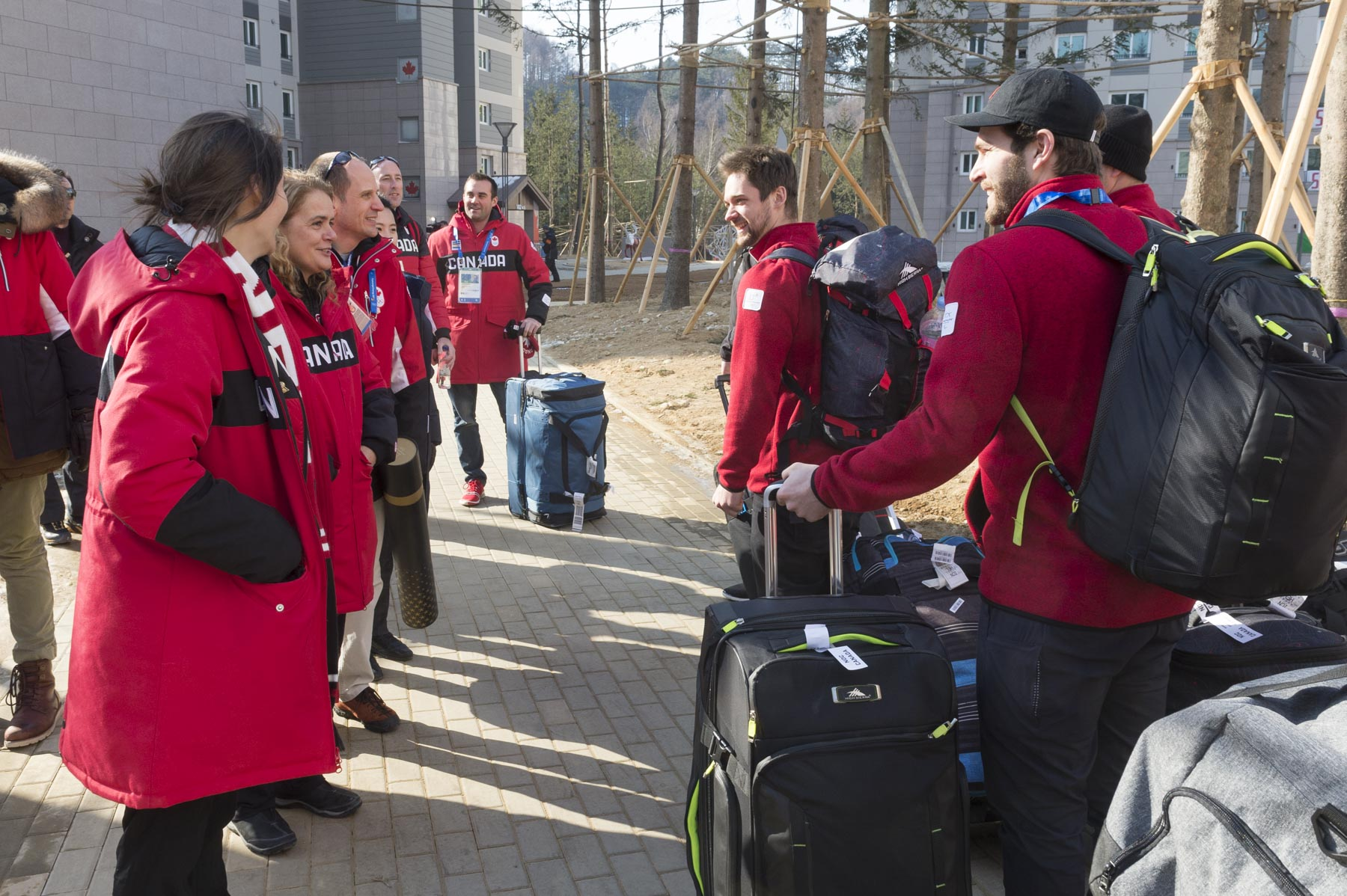 As Her Excellency was leaving, she met with snowboarders who were arriving in their new home during the Games.
