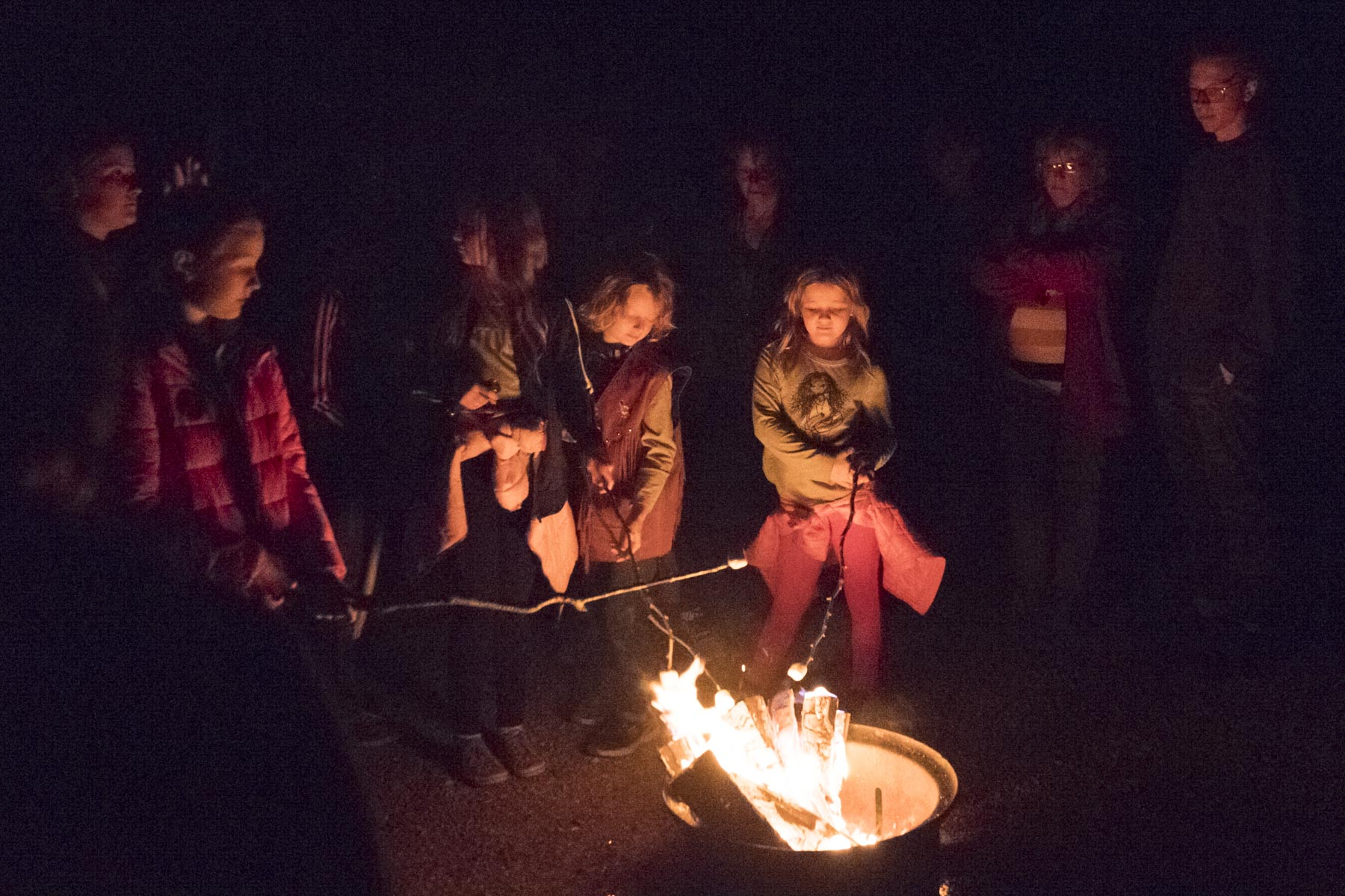 During the hike, kids roasted marshmallows on a camp fire.