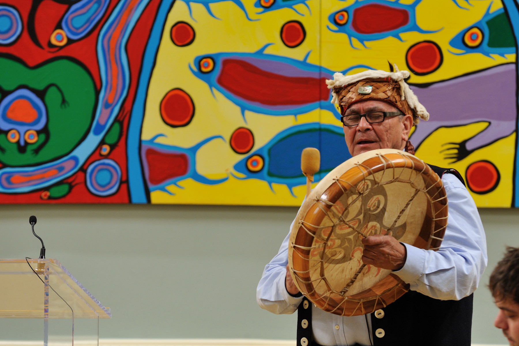 Chief Robert Joseph sang an honour song to welcome the Survivors of Indian Residential Schools with their youth family members and the members of the Survivors Committee.