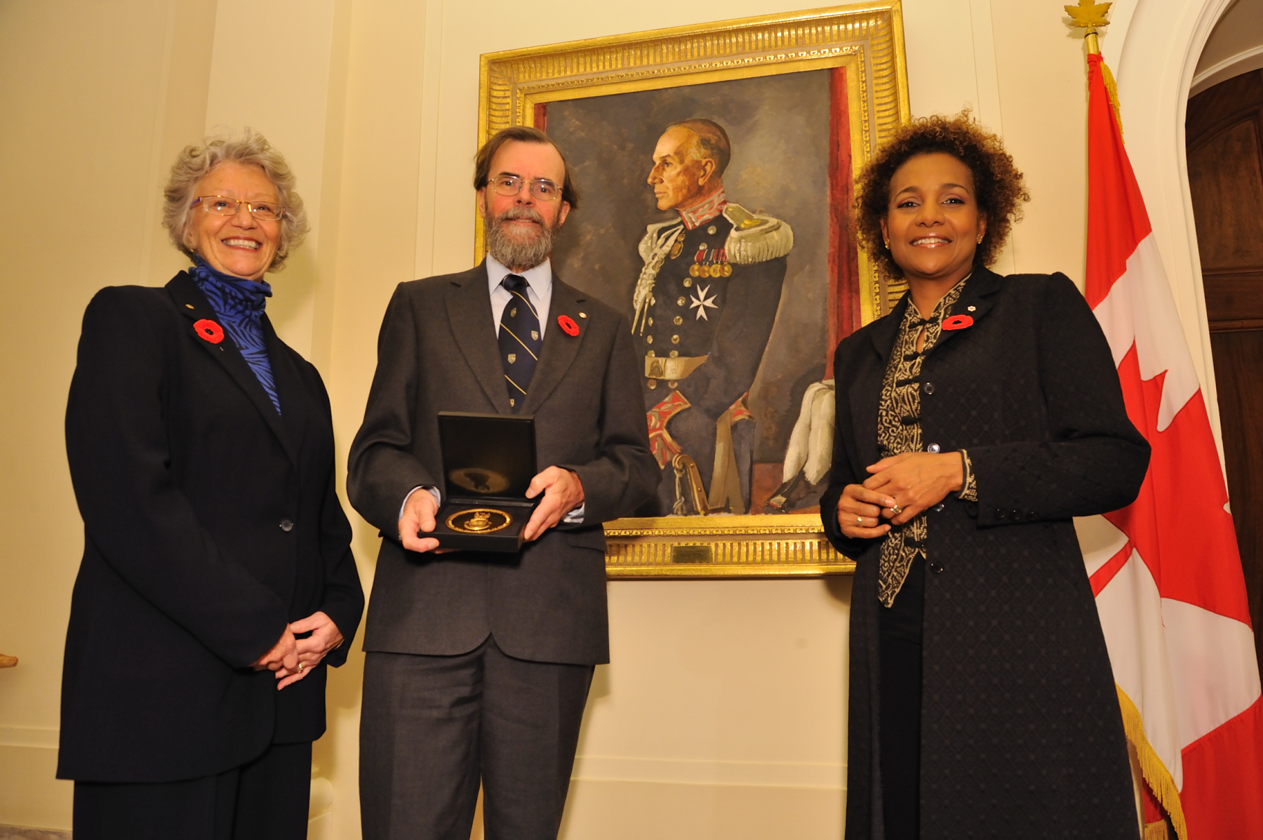A picture of the laureate with Her Excellency and Ms. Jacob was taken after the ceremony in front of former Governor General Vincent Massey's portrait who, in 1959, first awarded the medal administered by the Royal Canadian Geographical Society.