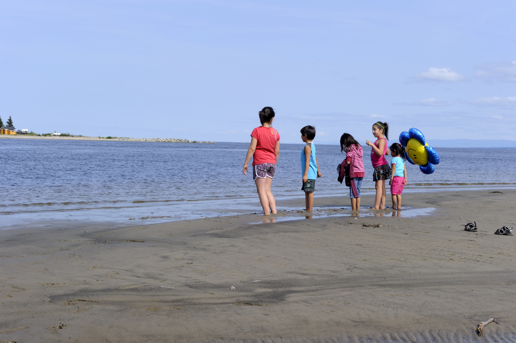 During the Governor General's visit, children of the community were playing on the beach.