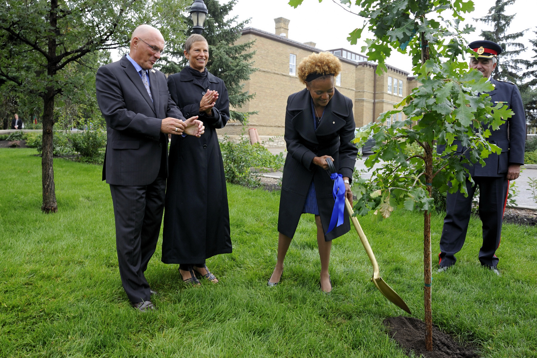 In honour of her visit to the province, the Governor General planted a tree in the Edwardian Gardens at Government House in the presence of Their Honours, the Honourable Dr. Gordon L. Barnhart, Lieutenant Governor of Saskatchewan and his wife Mrs. Naomi Barnhart.