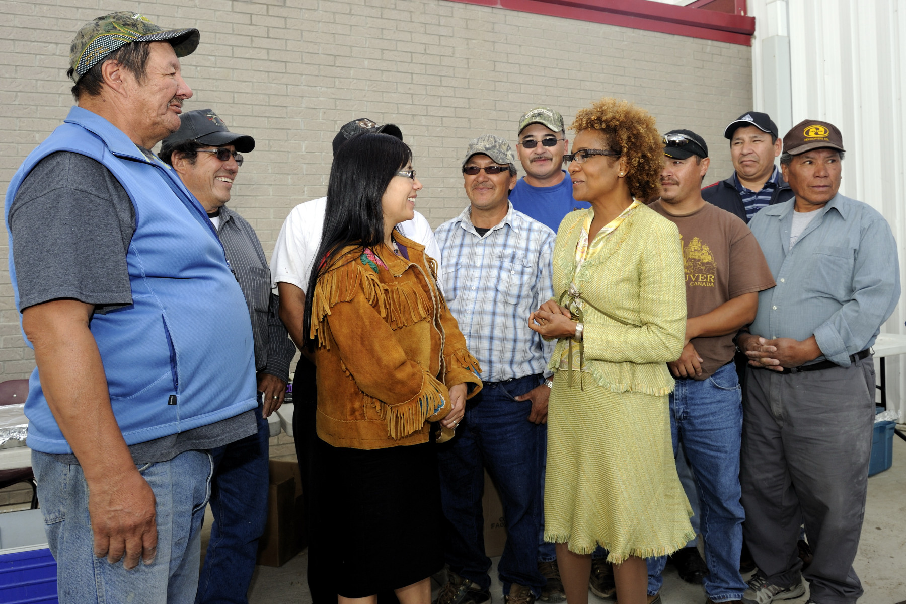 Chief of the Lac La Ronge Indian Band Ms. Tammy Cook-Searson (left) introduced Her Excellency to the fishermen responsible for providing the fish at the community celebration.