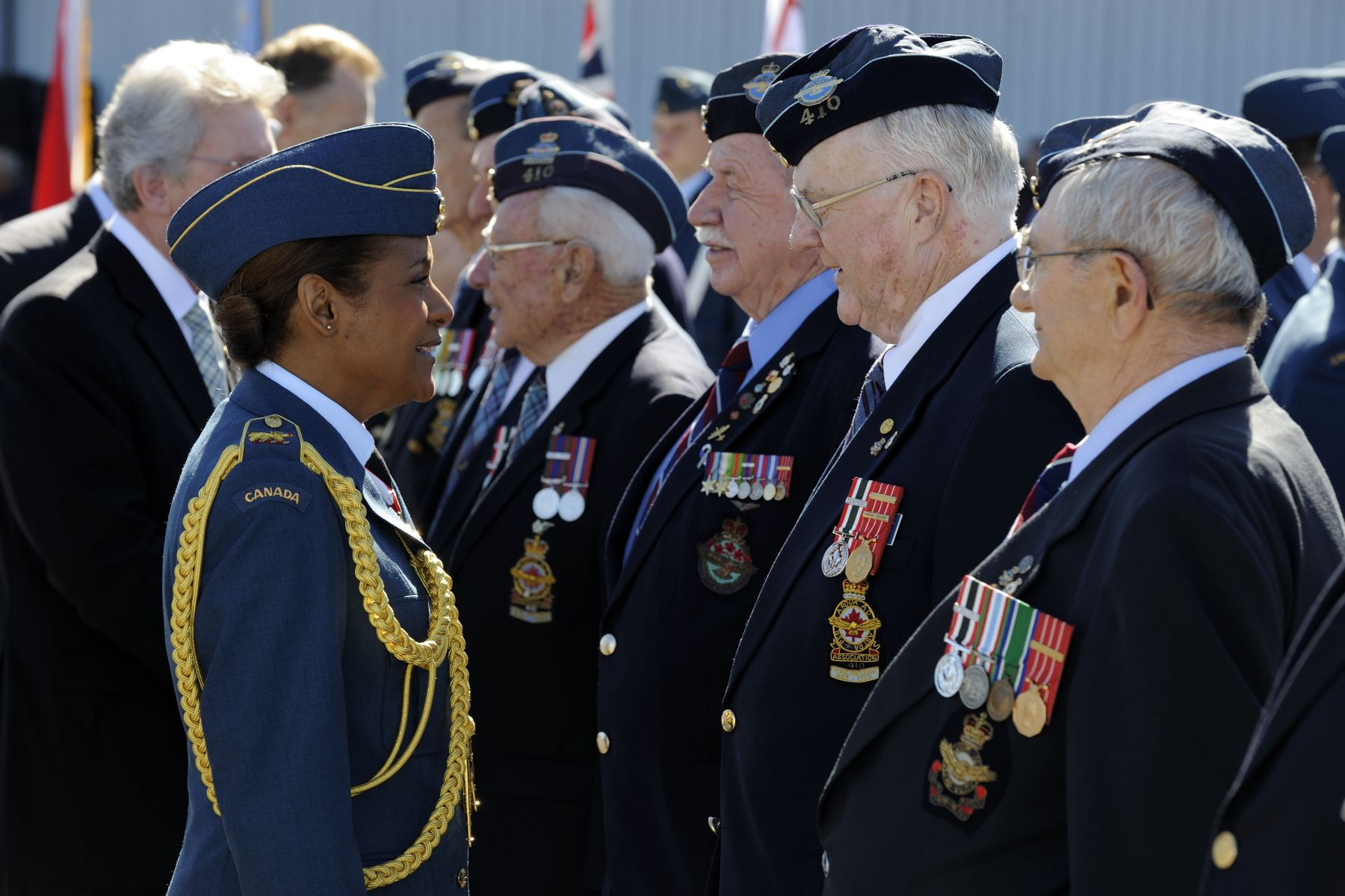 Her Excellency inspected the guard, starting with the veterans.