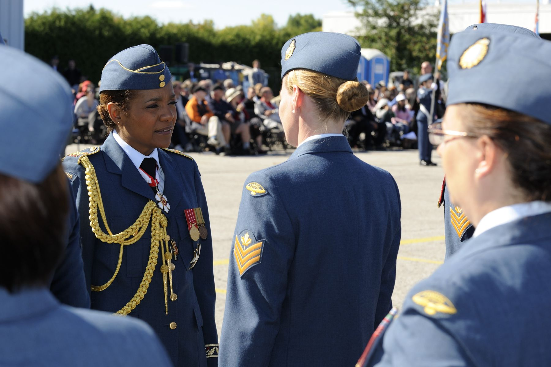 The Commander-in-Chief continued the inspection with Air Force active members, including women.