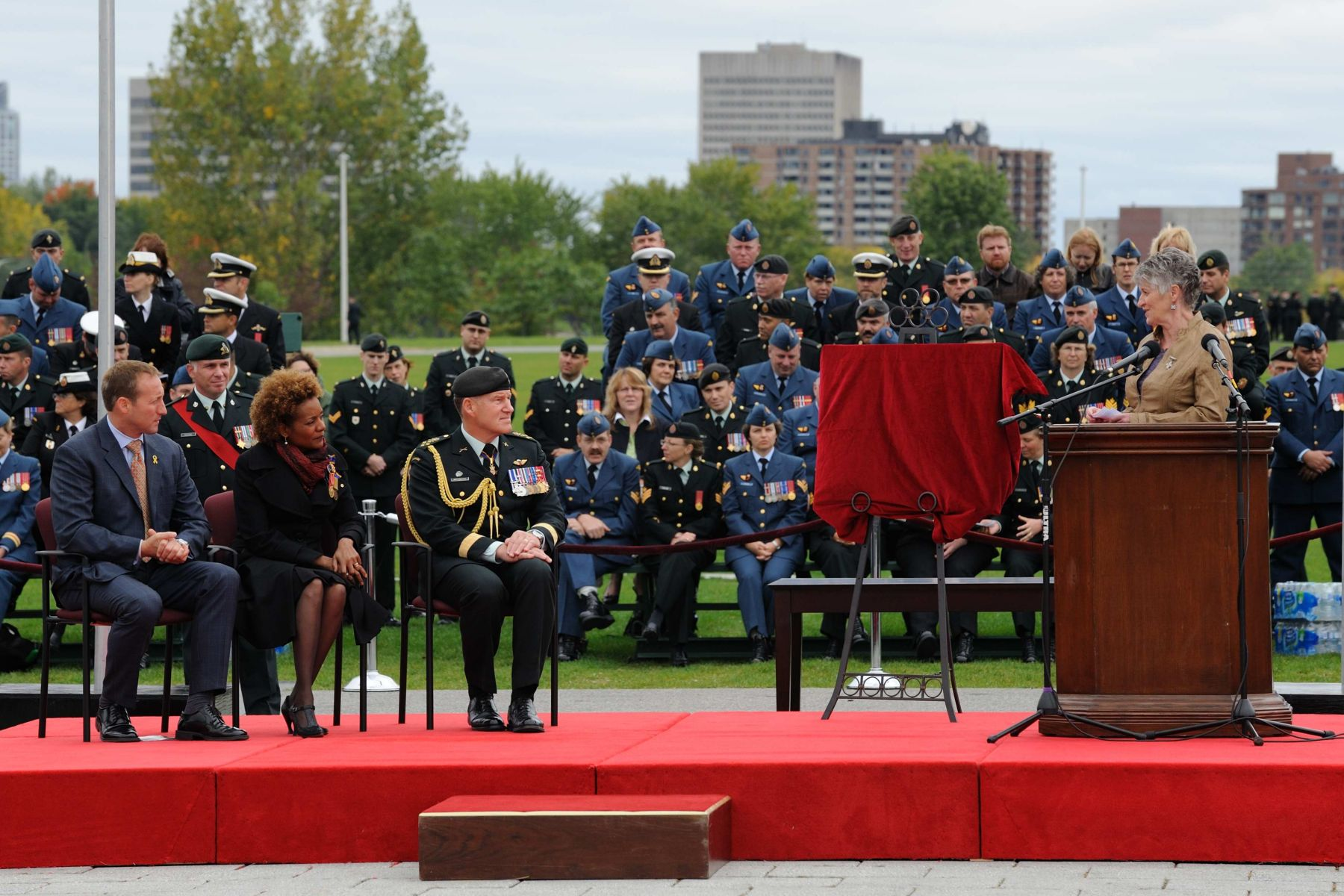 Silver Cross Mother Mrs. Della Marie Morley also addressed Her Excellency during the military ceremony.
