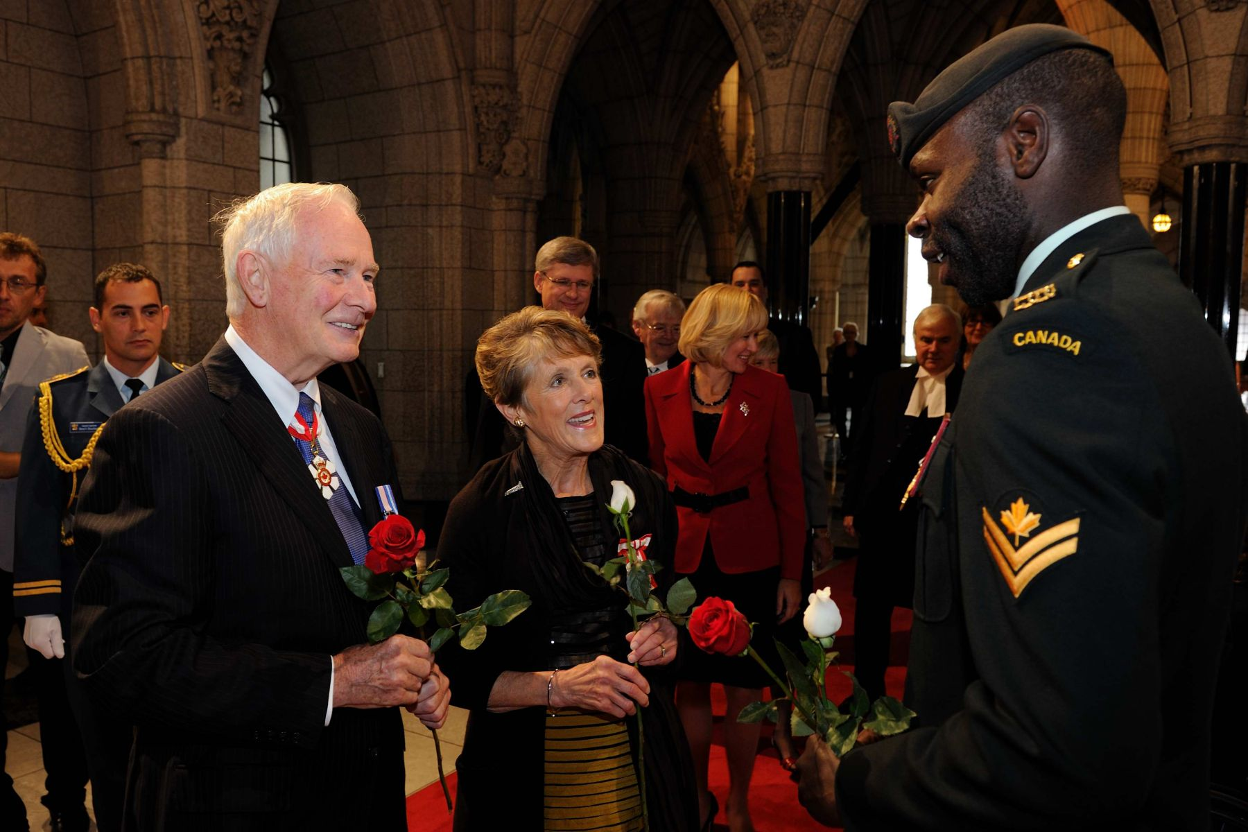 As Mr. and Mrs Johnston proceeded down the Hall of Honour of Centre Block, representatives from each province and territories presented them a flower.